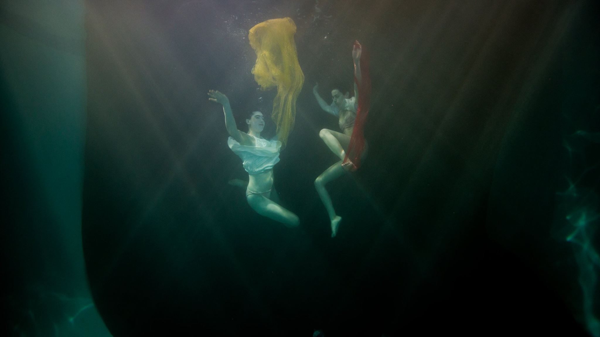 "Image from the ""ReEntry"" underwater music video shoot."