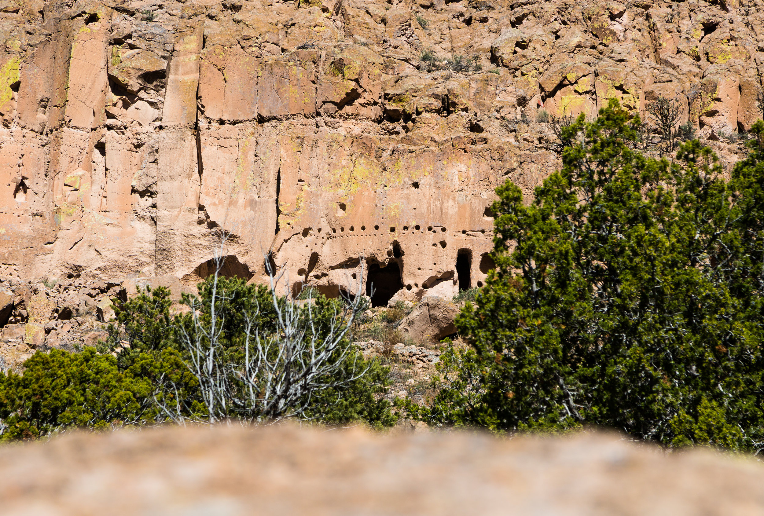 At first glance, the cliff (or cave) dwellings at Puye can blend right into the canyon walls.