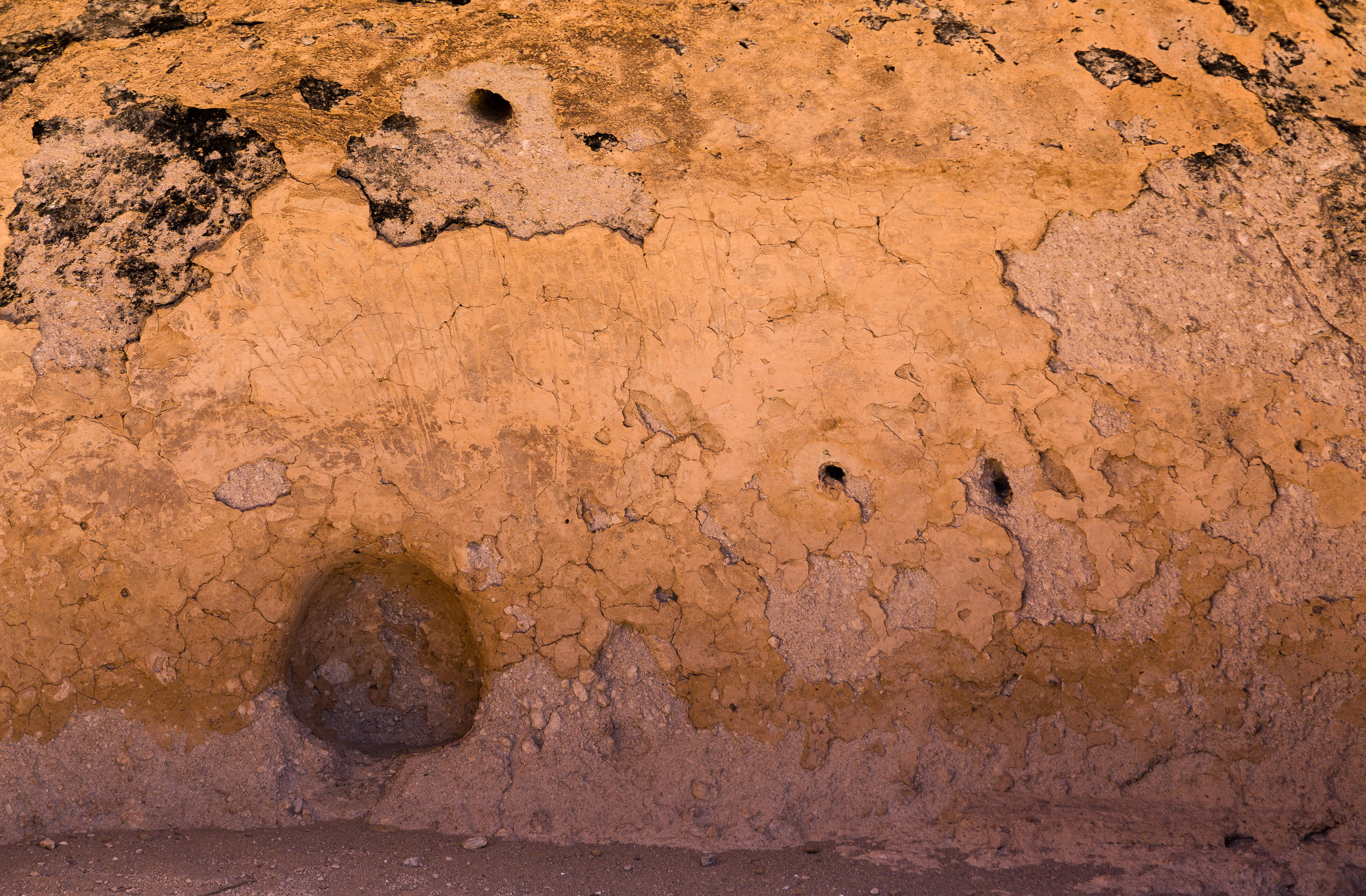 Wall niches are commonly found in ancient structures, and were likely used as shelves or storage. Original plaster is also visible here, as well as soot from ancient fires.