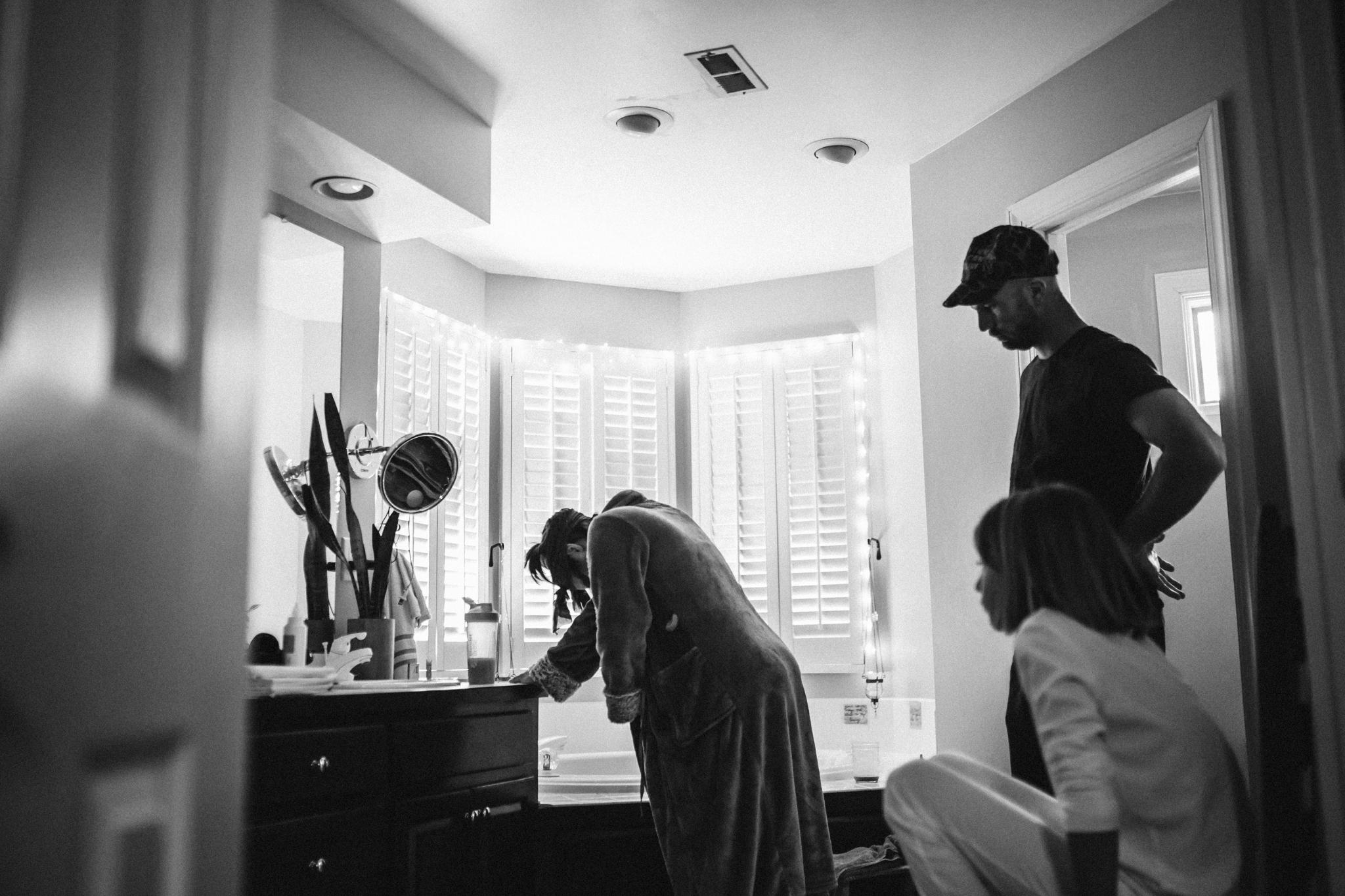 Rebecca burt photography casey in home birth black and white