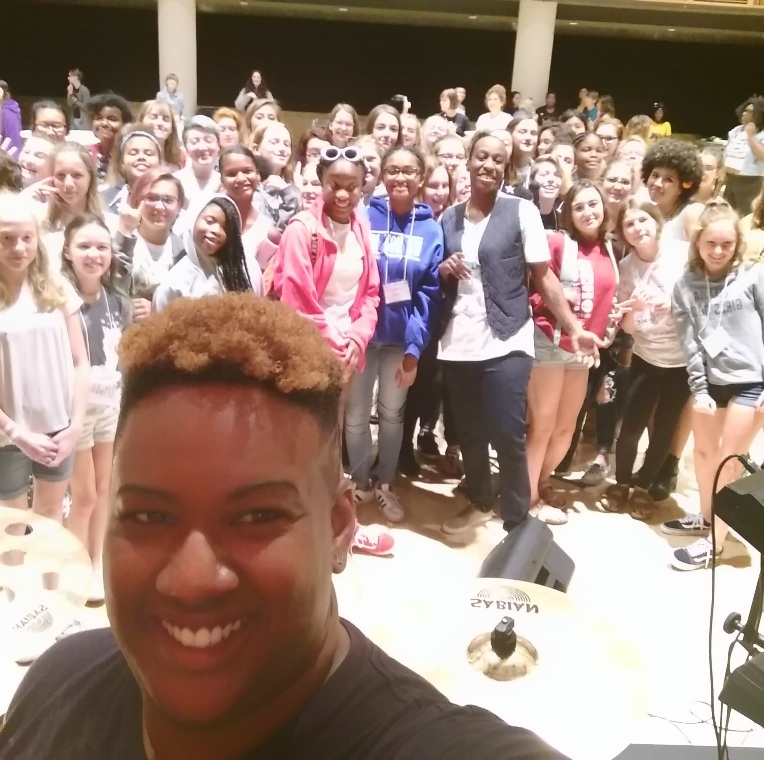 Students and Eden gathered for a fabulous, smile-filled selfie.