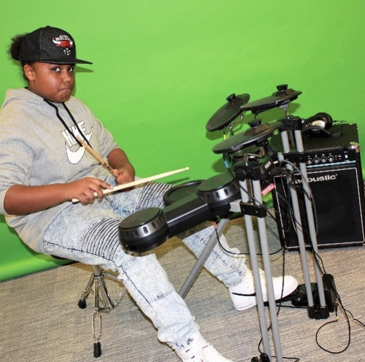A student learning drums in the first week of Girls. Inc programming.