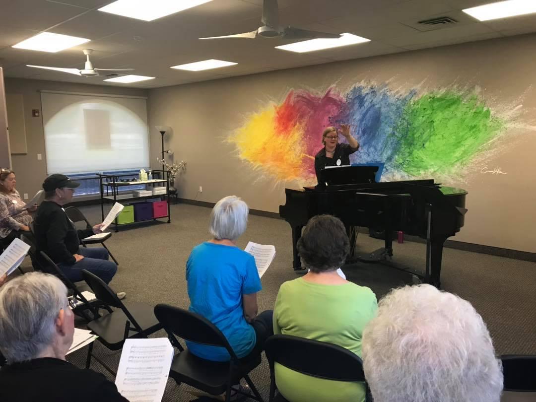 Co-Director Heather Hull Hart rehearses RiverWalk Day Choir, October 2018