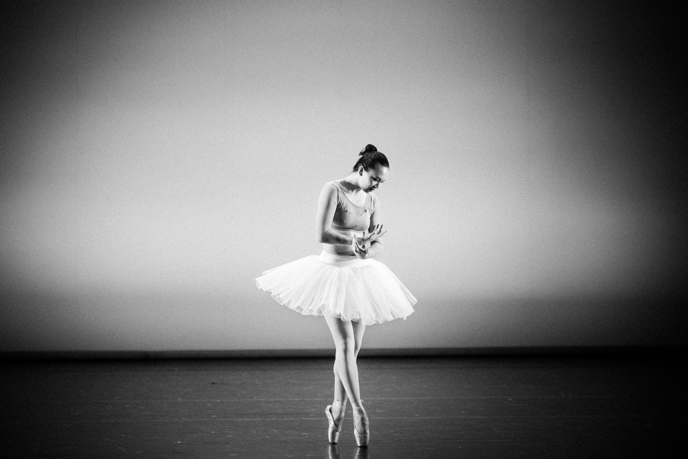 Ballet dancer in black and white on stage