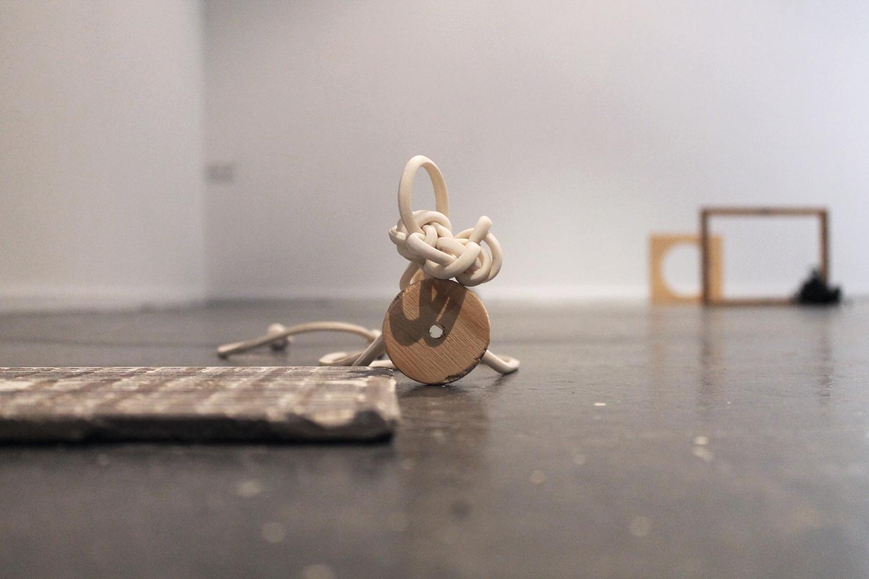 Zoe Knight, TREAD - soft white cord , 2015, rubber, wood, 10cm x 5cm x 10cm. Photo courtesy Zoe Knight.