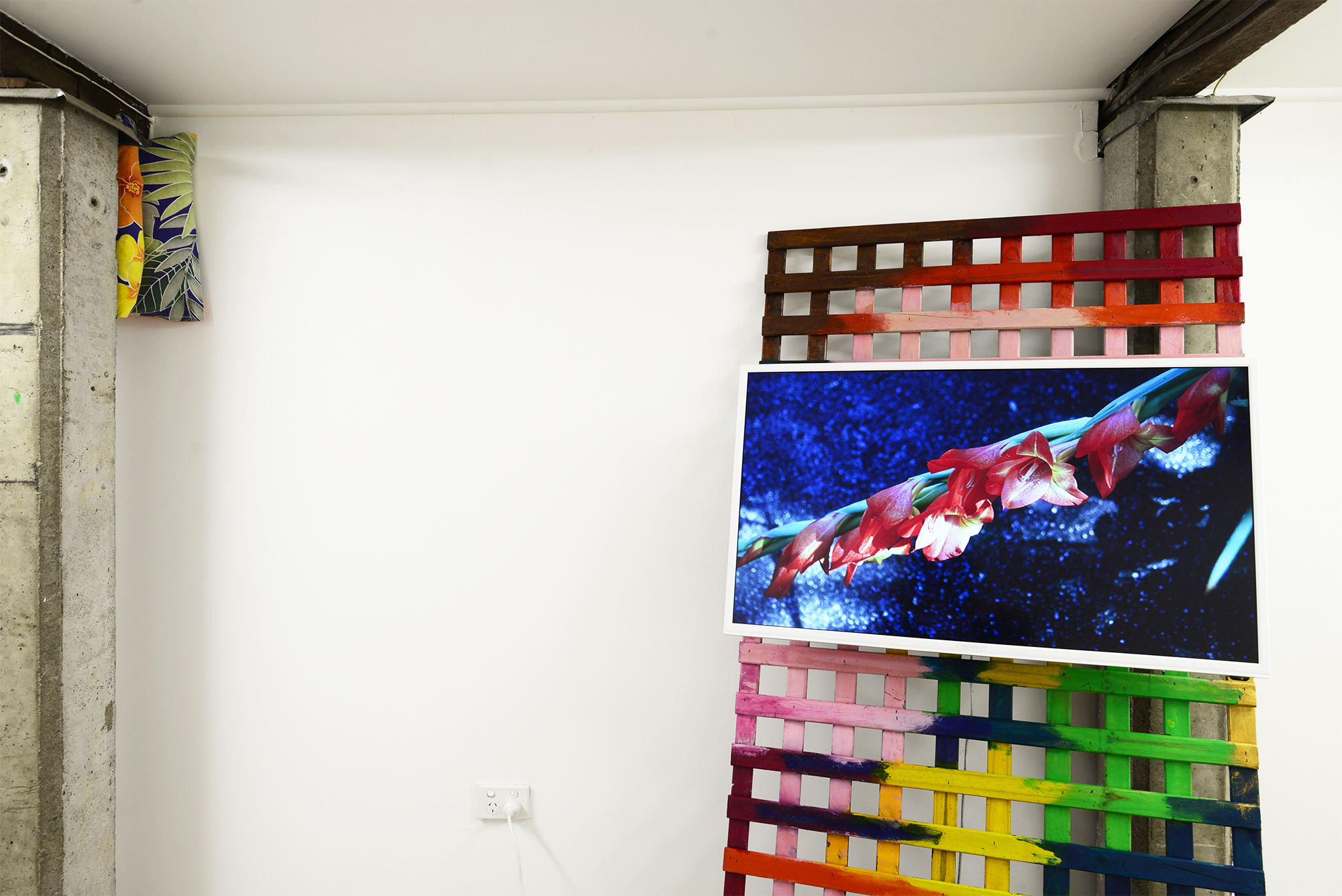 Left:  Rest  2018 pillow, pillowcase; Right:  Highgate Hill  c.1998/2018 slideshow on flatscreen TV: 35mm Kodachrome slides transferred to JPEG, 0:10, silent