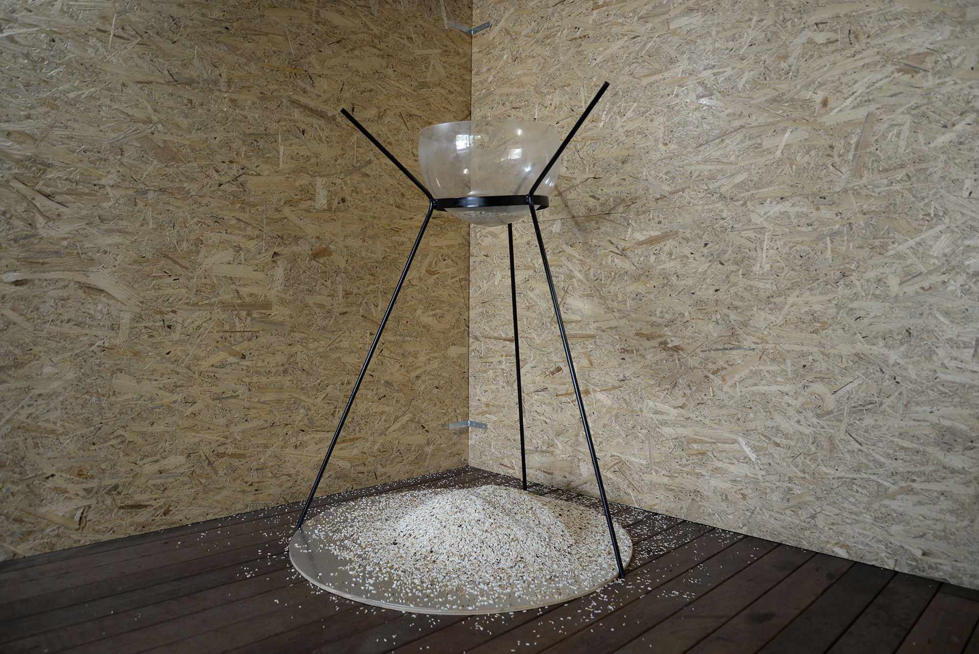 Hourglass  2018 steel, plastic bowl, metal sheet, rice