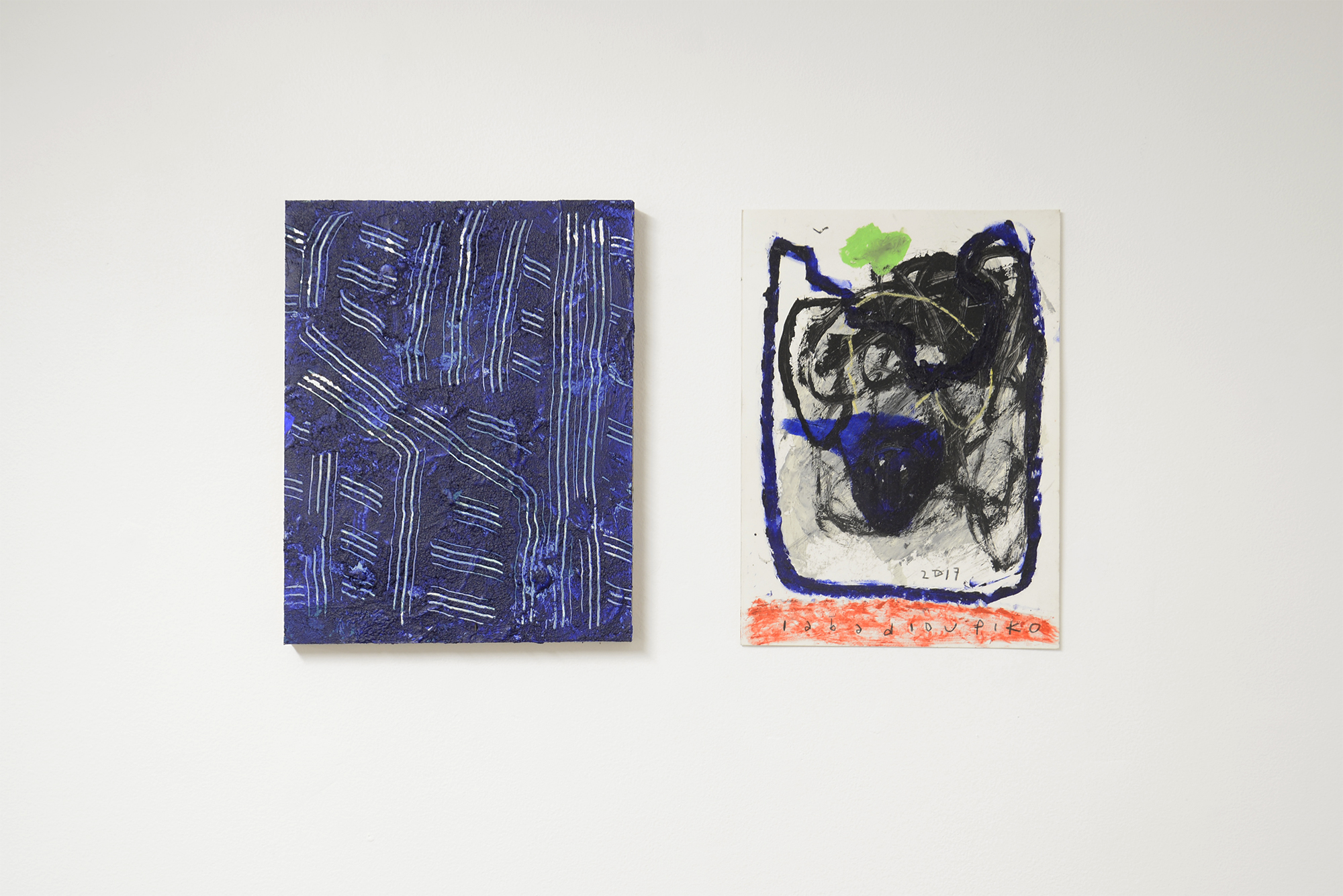 Left: Loki Groves  Free face  2018 acrylic on plywood  Right: Iabadiou Piko  Untitled  2017 acrylic, oil stick, oil pastel, pencil on paper