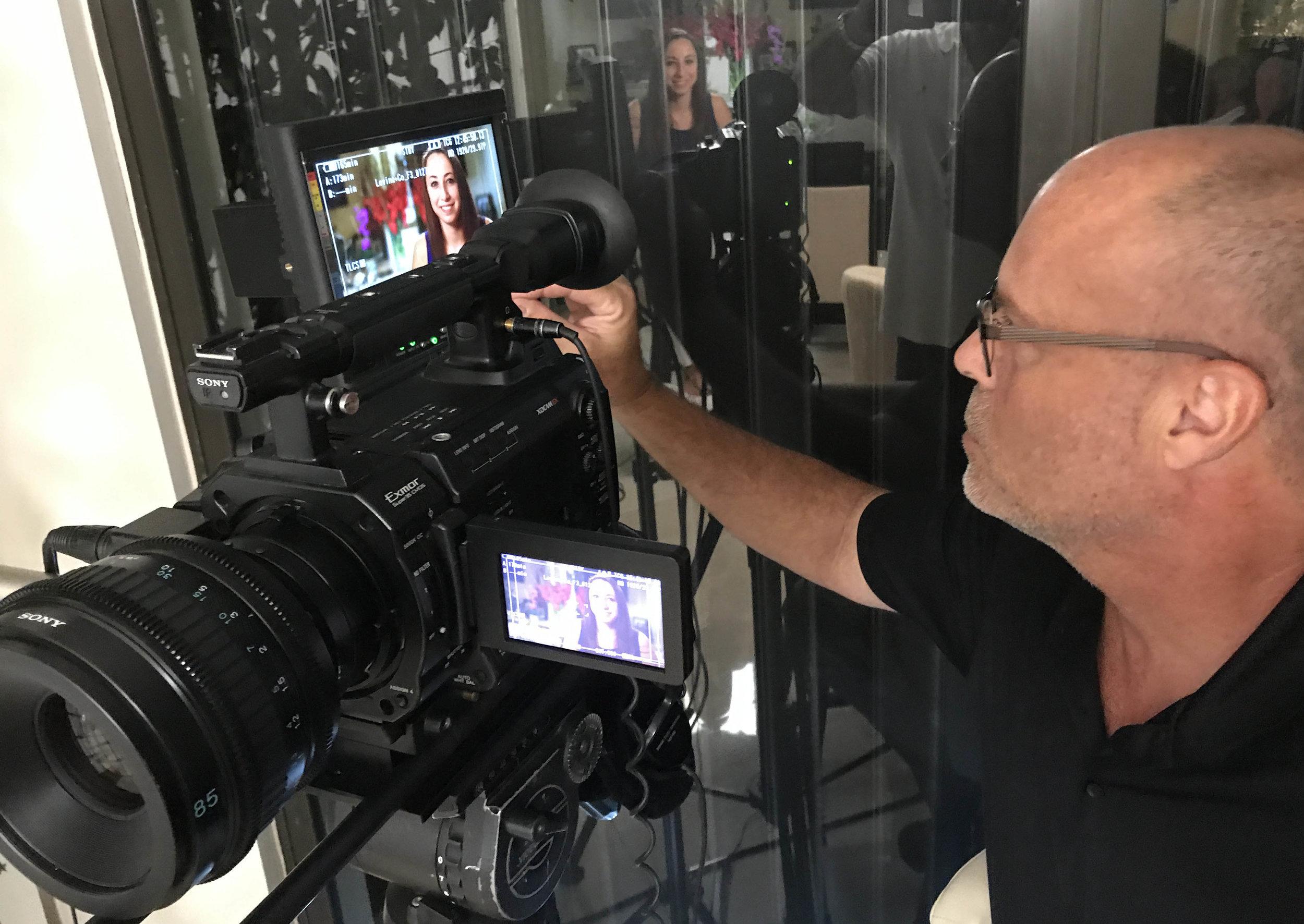 Steve composing and lighting UM Graduate Jackie Arvedon's video frame.