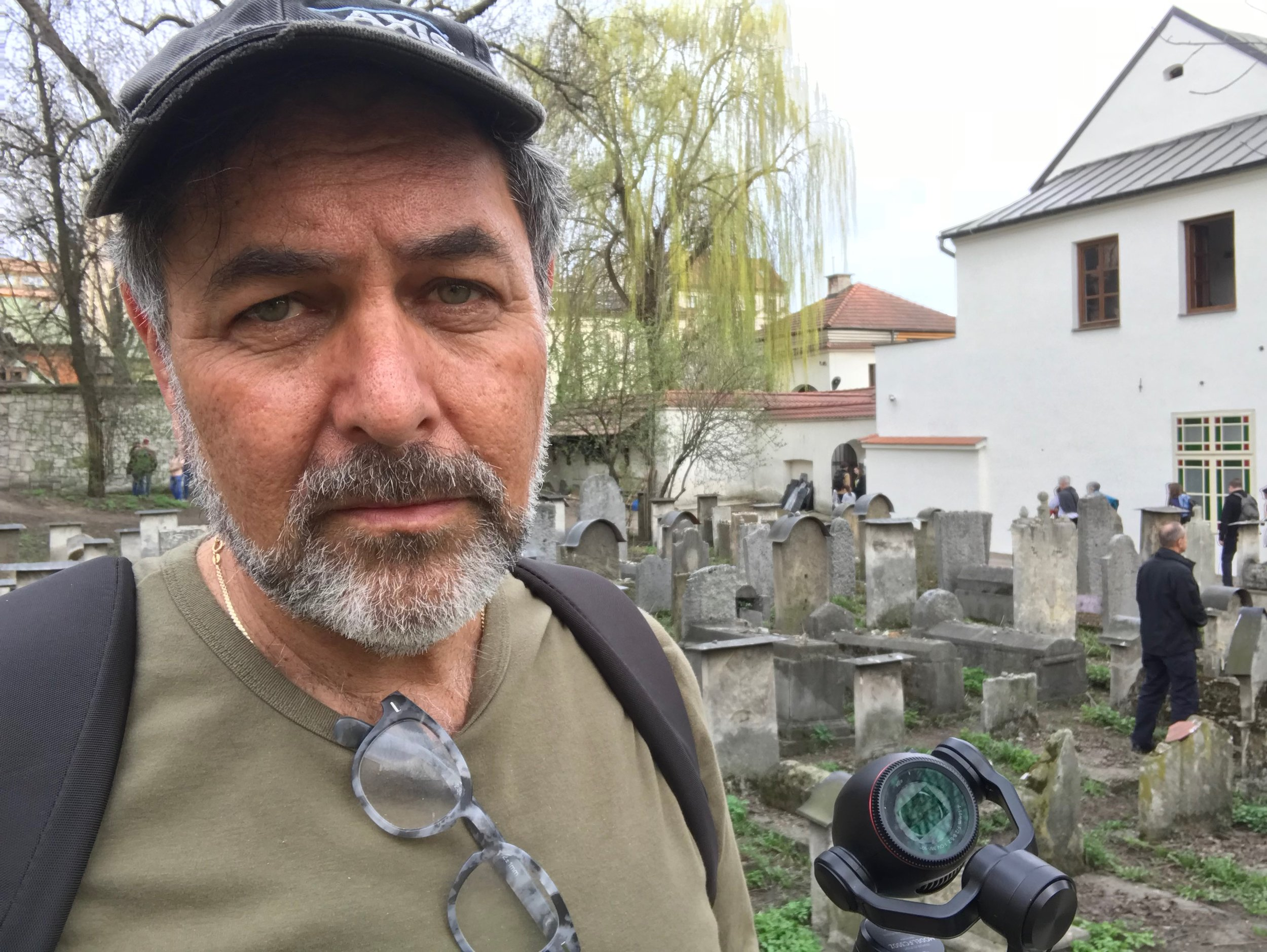 Jerry Levine on location filming in Poland - the Remah Synagogue can be seen behind him. During World War II Krakow's buildings and landmarks escaped mostly unscathed. Its preservation makes it a key destination for Holocaust Survivors, students and Jewish missions, such as this one organized by the Greater Miami Jewish Federation.