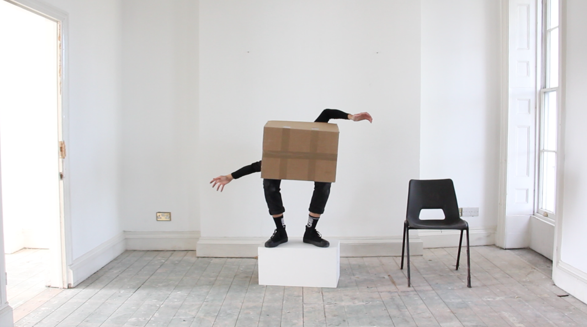 Still from A chair, a plinth and a cardboard box video studies 01.