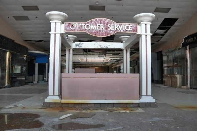 """From Seth Lawless's """"Black Friday: The Collapse of the American Mall"""", the former customer service kiosk at the Randall Park Mall in Ohio"""