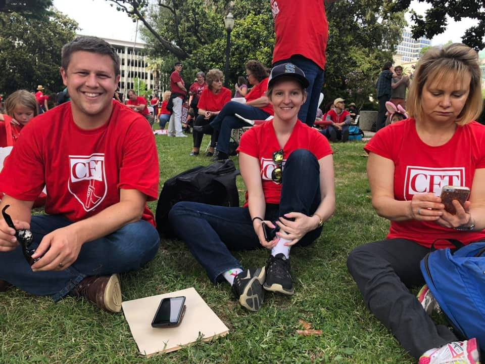 Matt Bruner with Sarah Rominger and Jessica Murray at Red for Ed in Sacramento