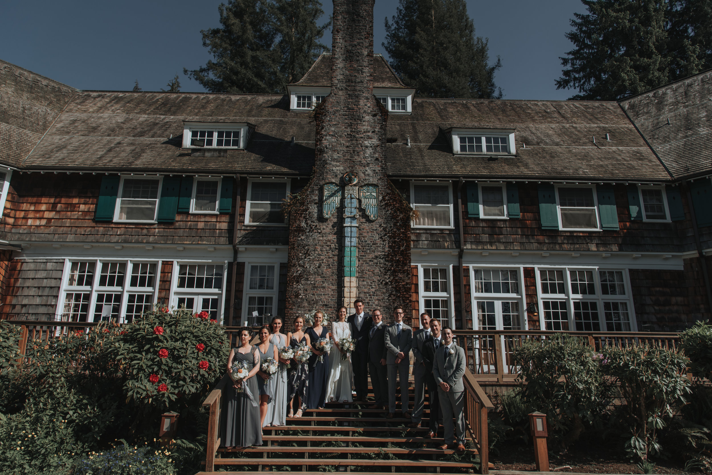 The wedding party posing in front of the  Lake Quinault Lodge . Photo by Logan Smith Photography.