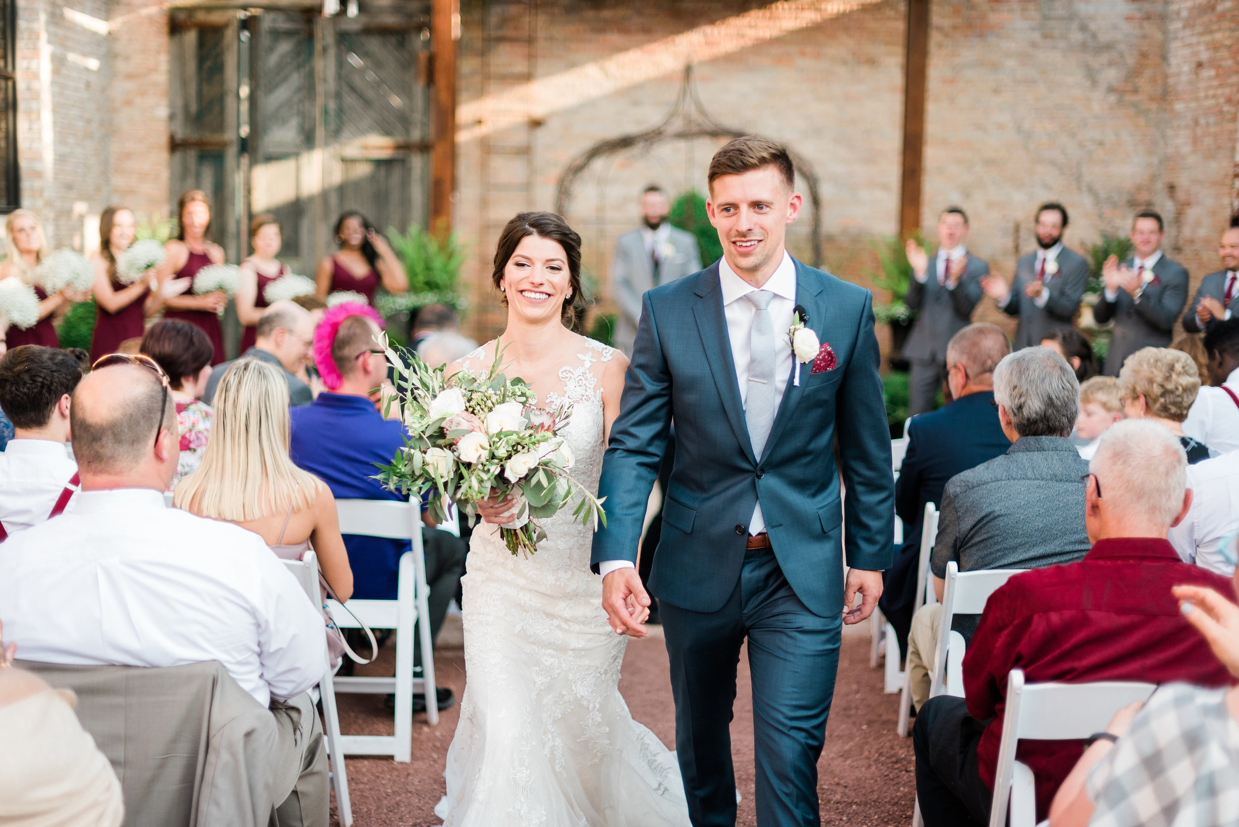 Maggie &Brad - Sycamore, ILVenue: Blumen GardensPhotographer: Danielle Heinson PhotographyGuest Count: 185Vibe: RomanticBest part of our wedding? Our venue!