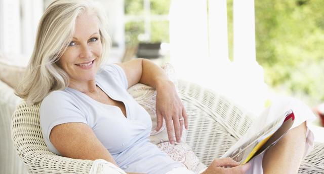 Senior-Woman-Sitting-Outside-Reading-Magazine.jpg