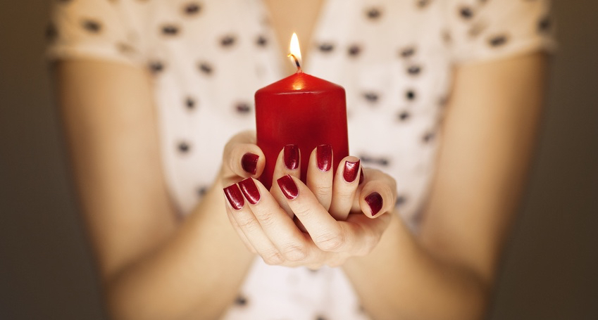 Woman-hands-holding-a-candle-light.jpg