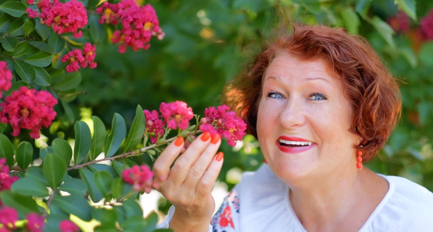 Mature-red-haired-woman-dressed-in-an-embroidered-blouse-with-flowers.jpg