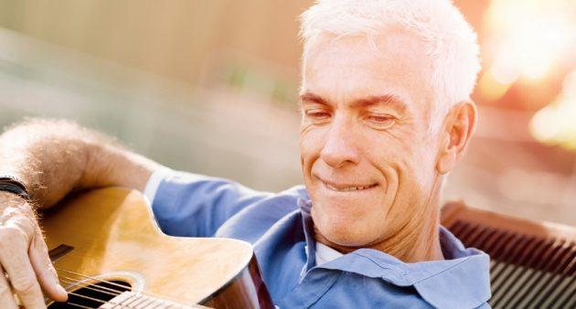 Senior-man-plying-guitar-outdoors-630x338.jpg