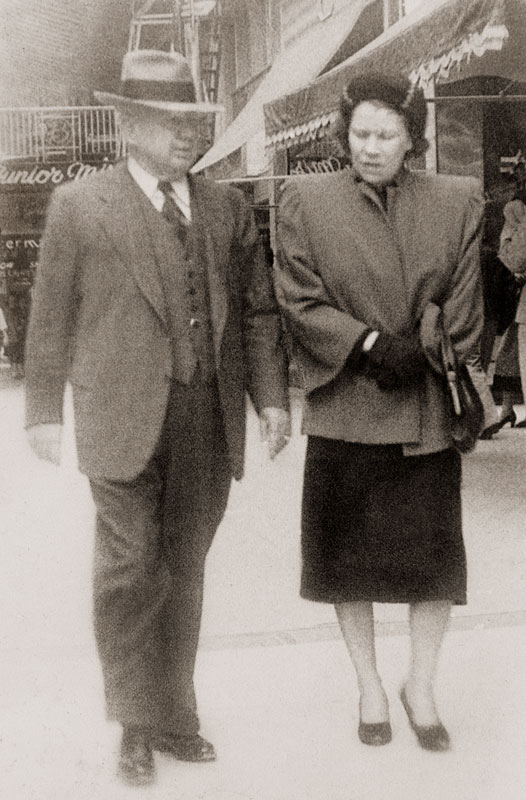 Ewing Halsell and Helen Campbell walking down Houston Street