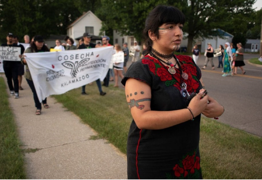 """Elvira Ubaldo Ace Ruiz IV leads a group of protesters during the """"Stop ICE holds and end mass incarceration vigil"""" held outside of the Kalamazoo County Jail where protesters gathered to end ICE cooperation, July 11, 2018.  Photo by Daniel Vasta, MLive.com"""