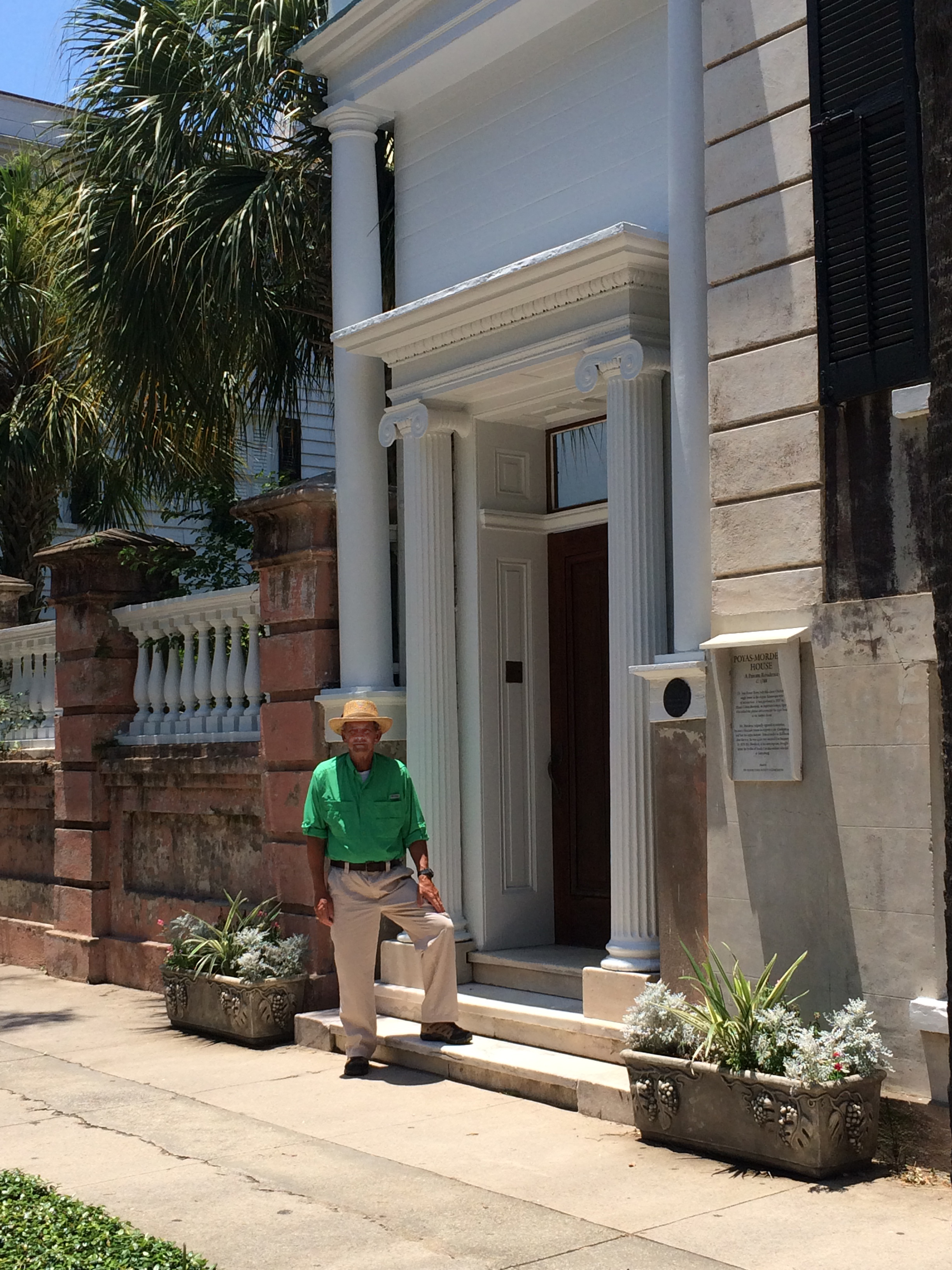 Skip Evans poses for a photo in front of his childhood home on Meeting Street.