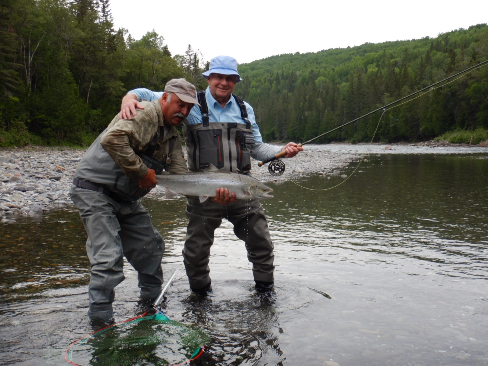 Long time Club guest Sheldon Aaron (right) landed this fine salmon on his first day out, congratulations Sheldon!