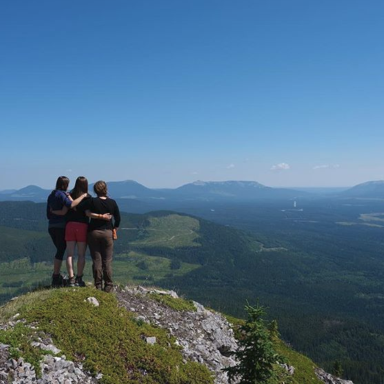 Navarana, Julie, and Sandra pause to take in the stunning scenery from a mountain peak.