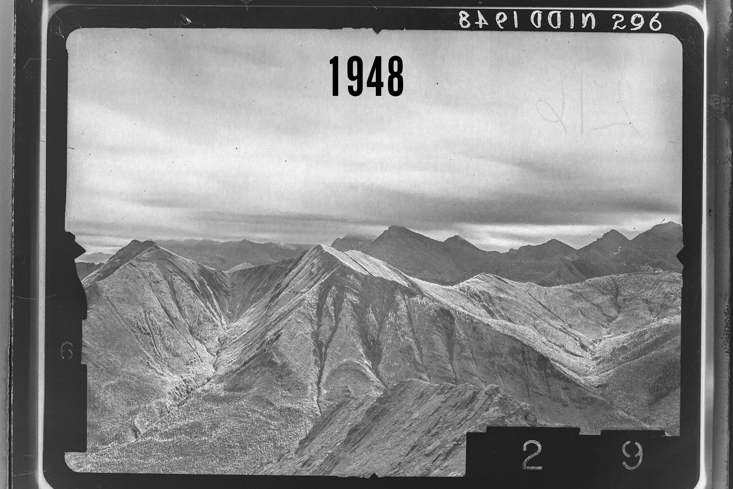 Historical Photograph taken on the south side of Mist Mountain by surveyors. Photo courtesy of the Mountain Legacy Project.