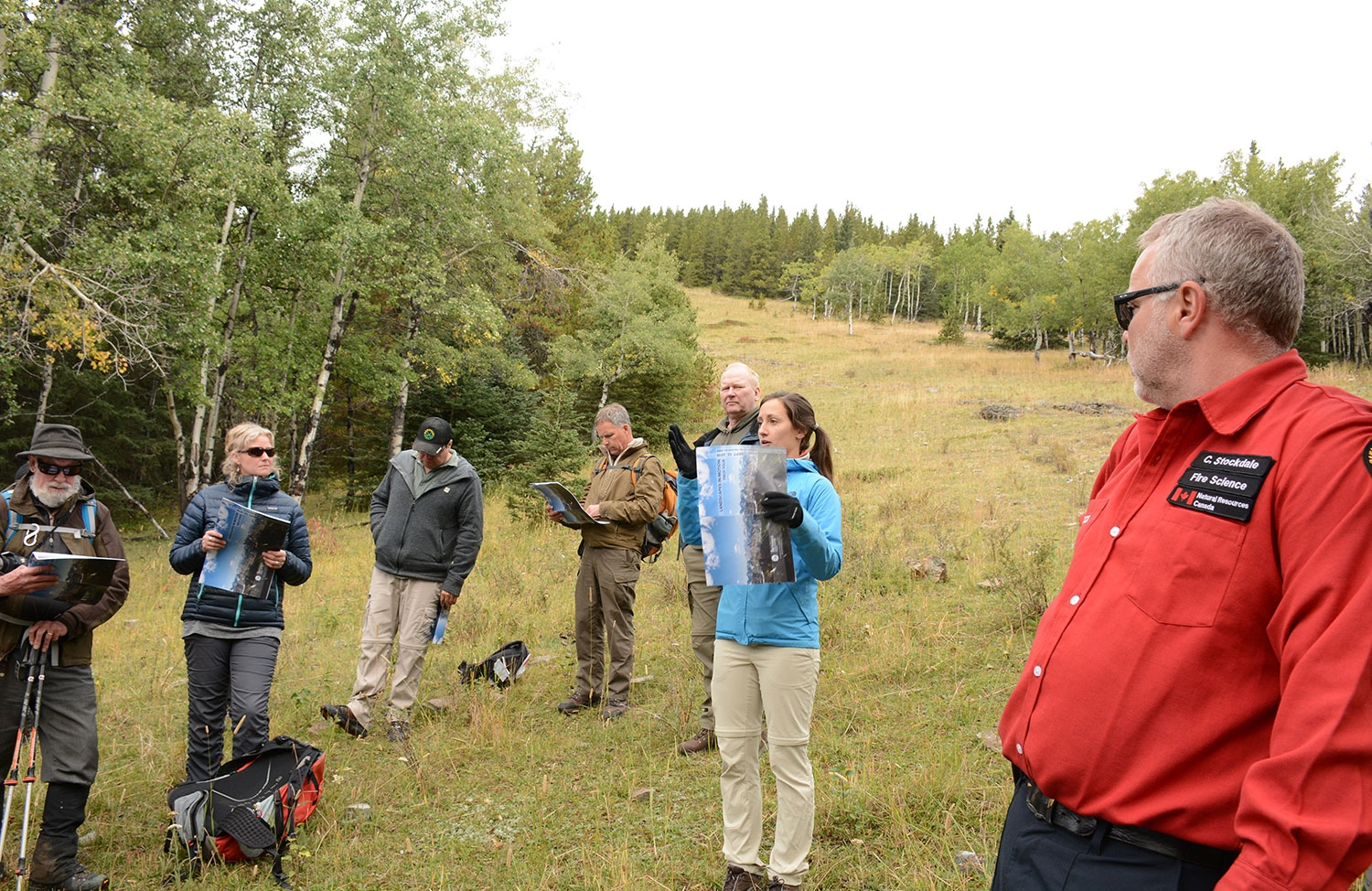 Julie Fortin (centre) and Chris Stockdale (right) present to the group. Photo by Cameron Naficy.