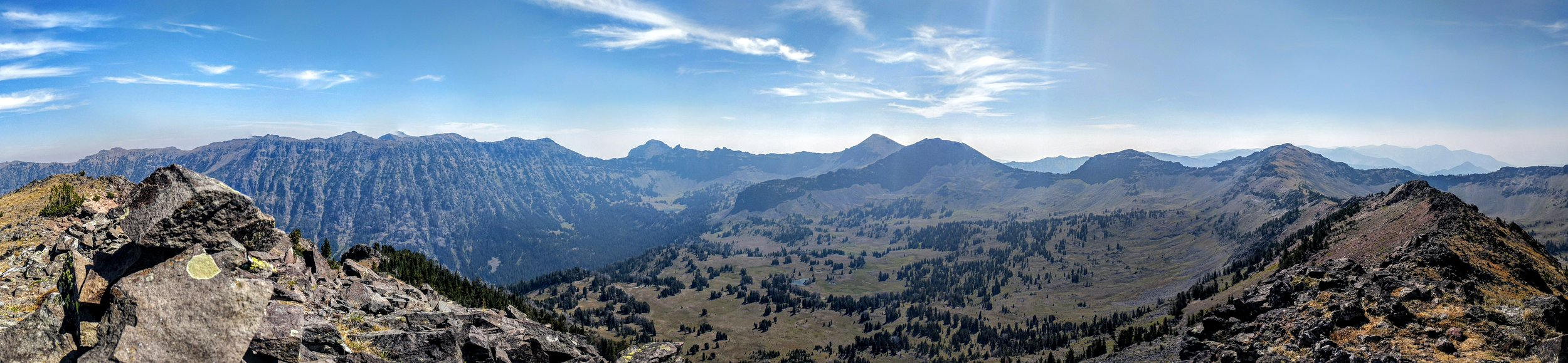 Looking southeast from Divide Peak, with views of the ridgeline to Hyalite Peak and the basin below