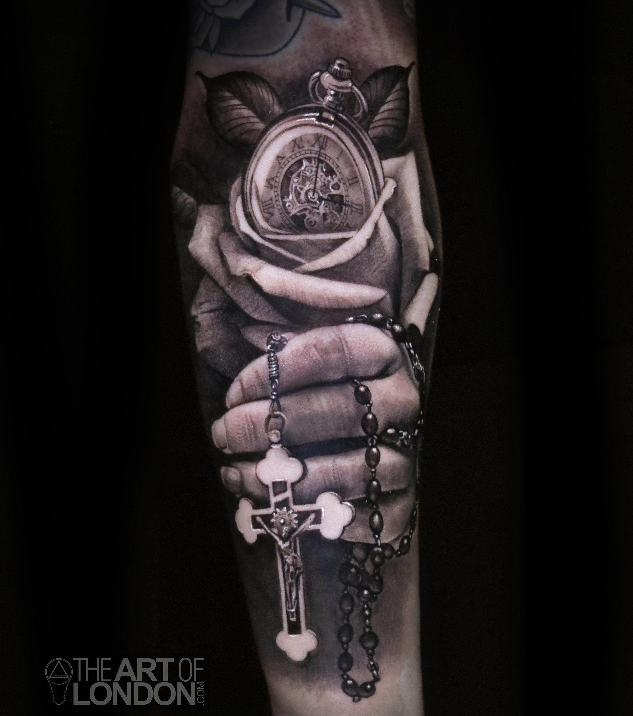 rosary hand rose crucifix tattoo.jpg