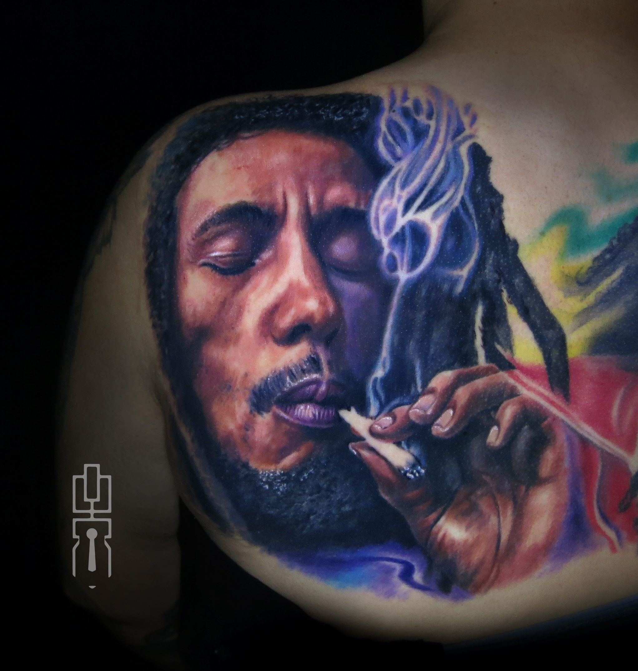 bob marley smoking tattoo.jpg