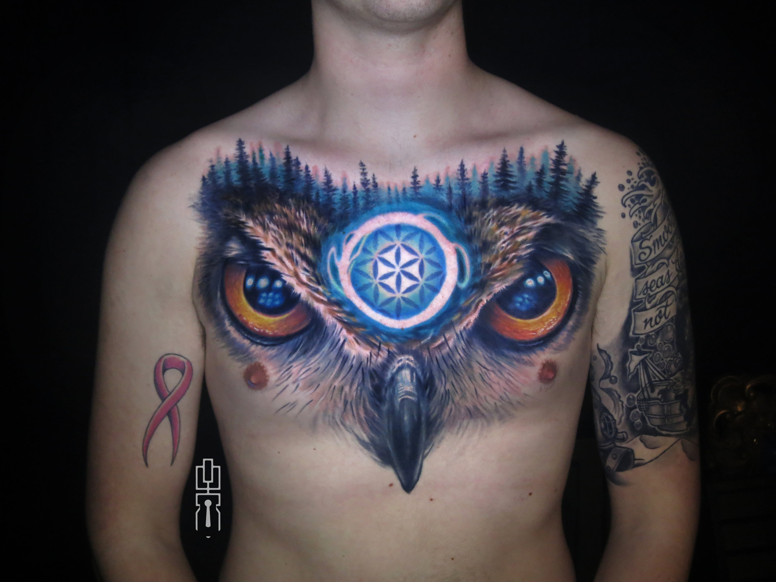 sacred flower of life owl chest piece tattoo.jpg
