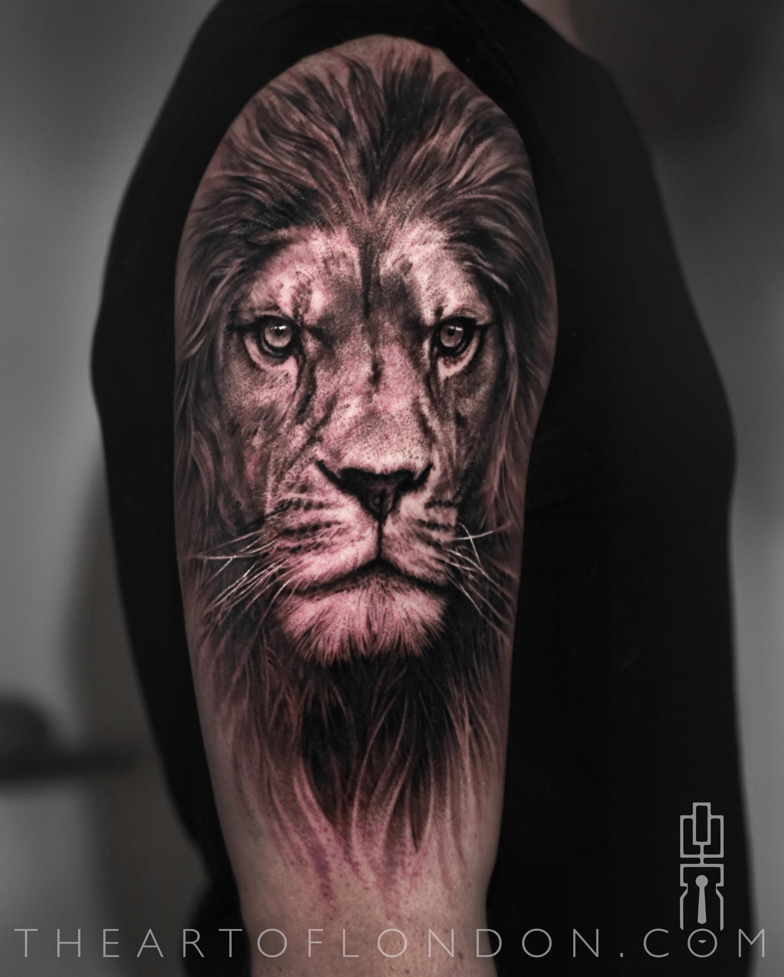 black and grey lion tattoo half sleeve.jpg