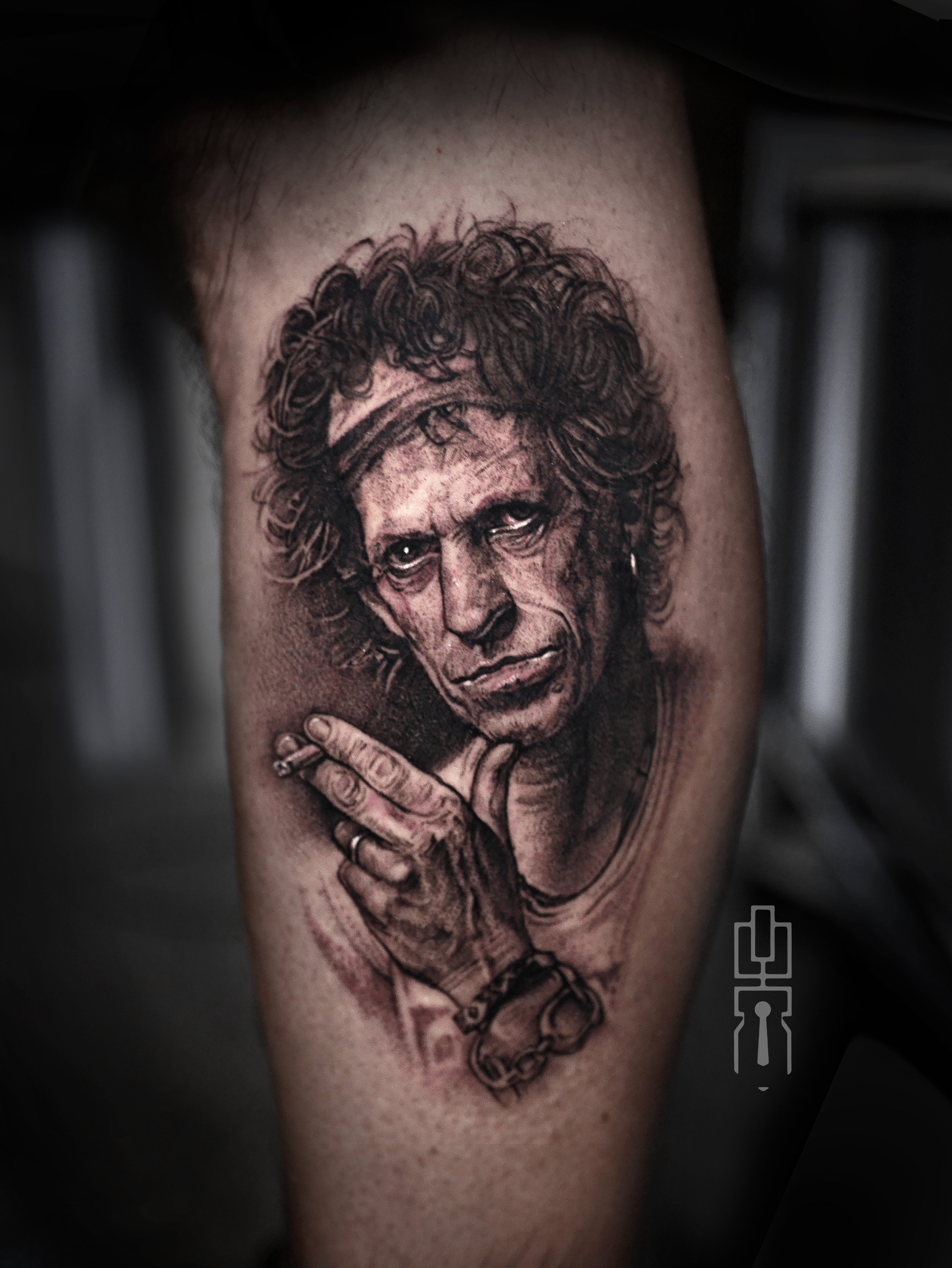 keith richards black and grey rolling stones tattoo.jpg