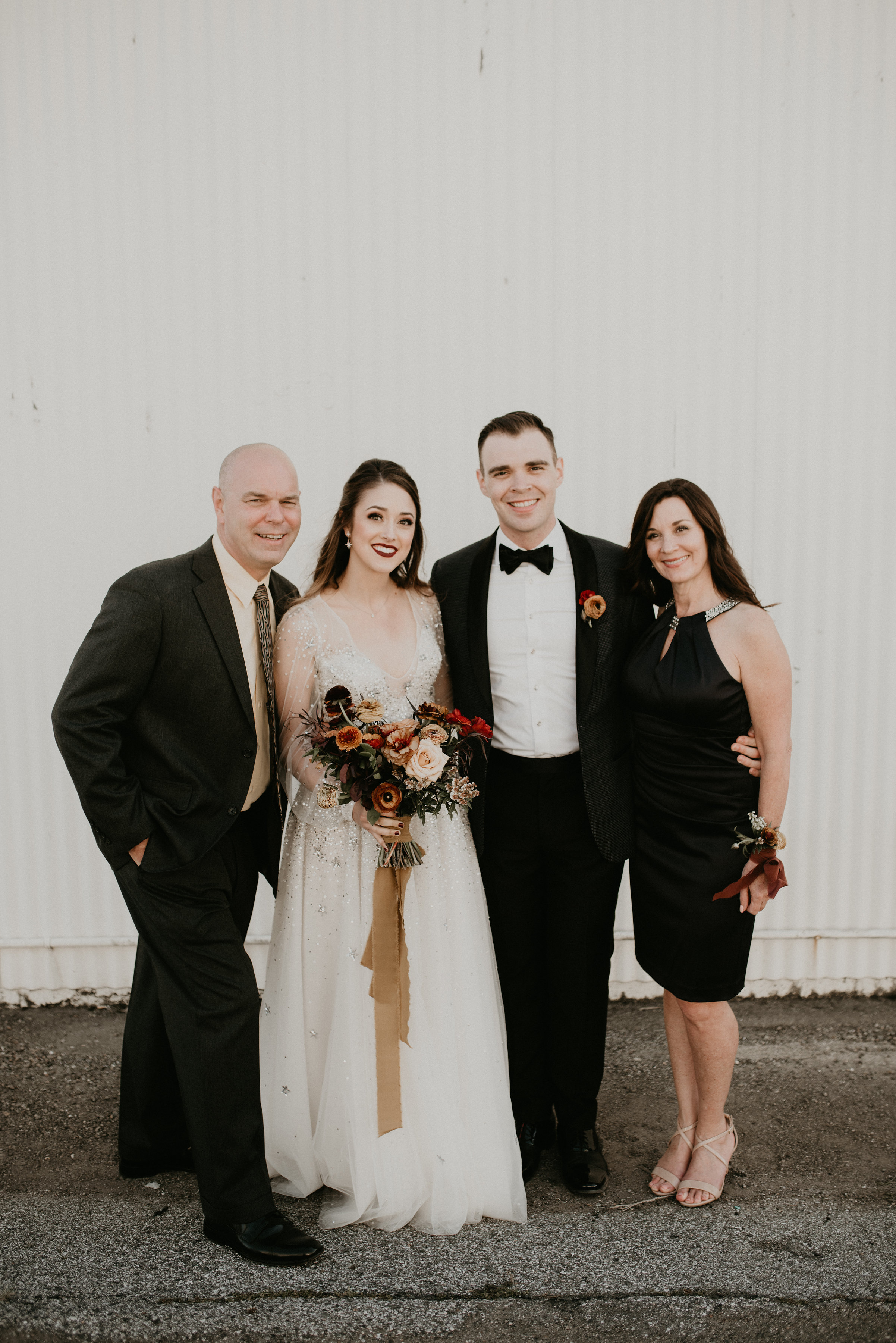 With my new parents-in-law at the wedding.
