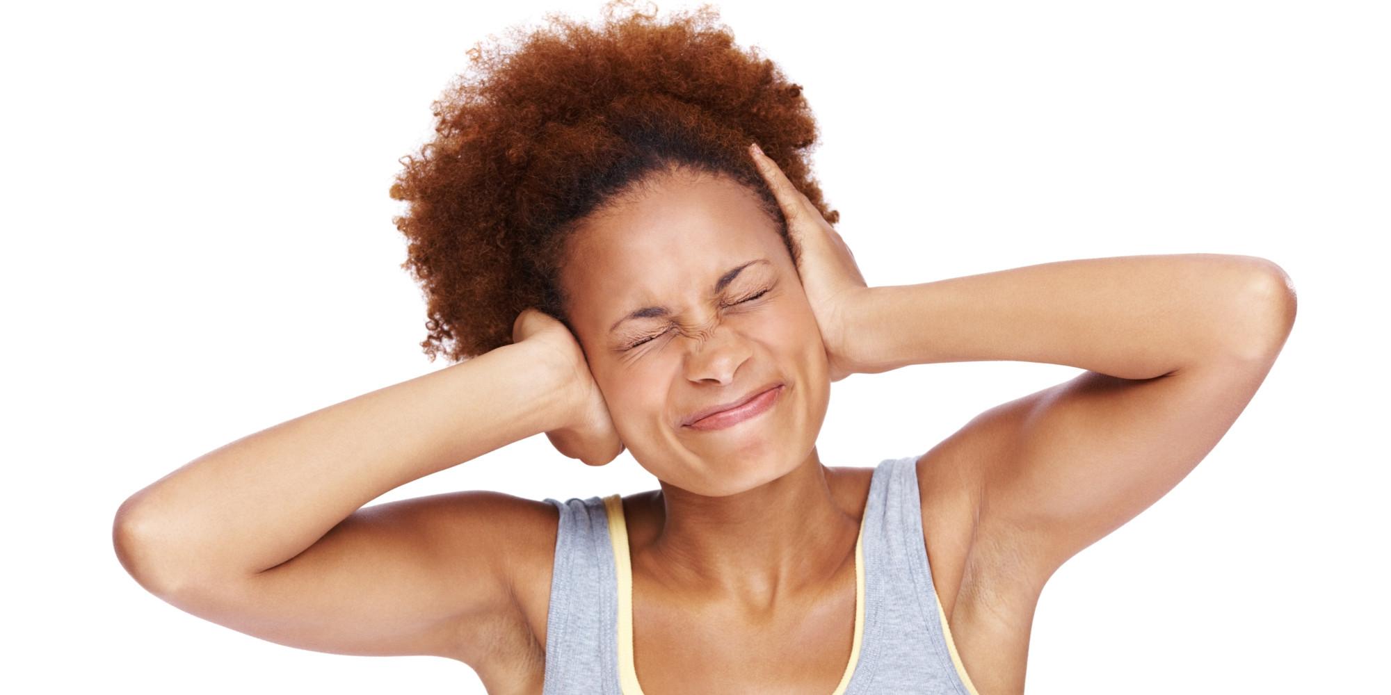 o-BLACK-WOMAN-COVERING-EARS-facebook.jpg