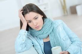 sad woman holding head.jpg