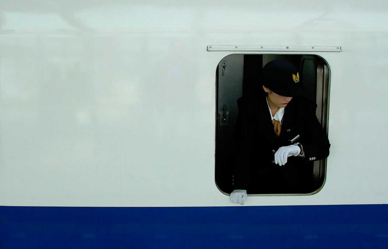 The Crisply-Pressed Uniform of a Shinkansen Conductor