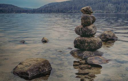 Counseling in Nashville - stacked rocks by mountain lake