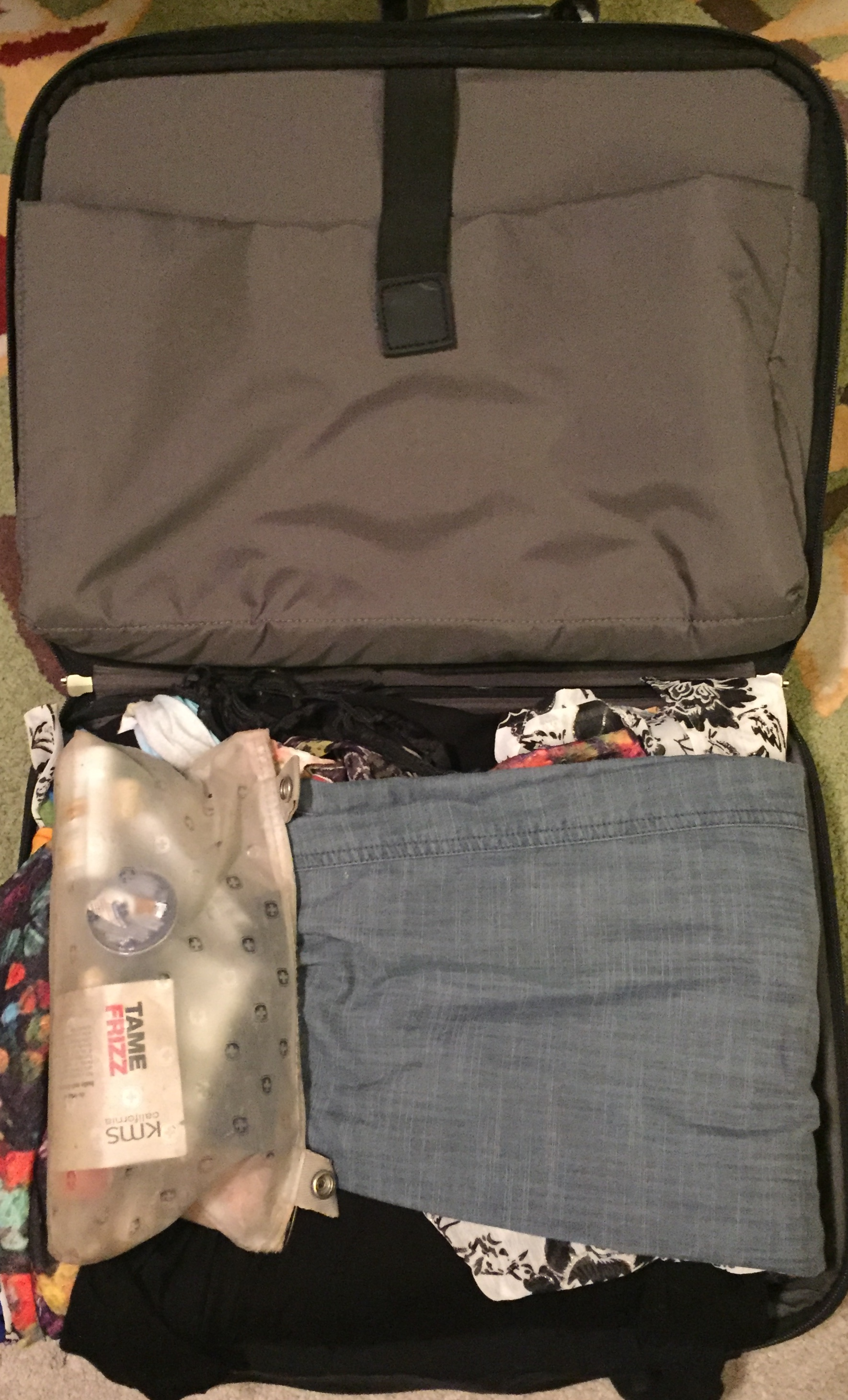 Image 2.  The suitcase with all the clothes folded over into one bundle. (My makeup bag is on top of the clothes however, I don't put this in until the clothes are placed into a plastic bag.)