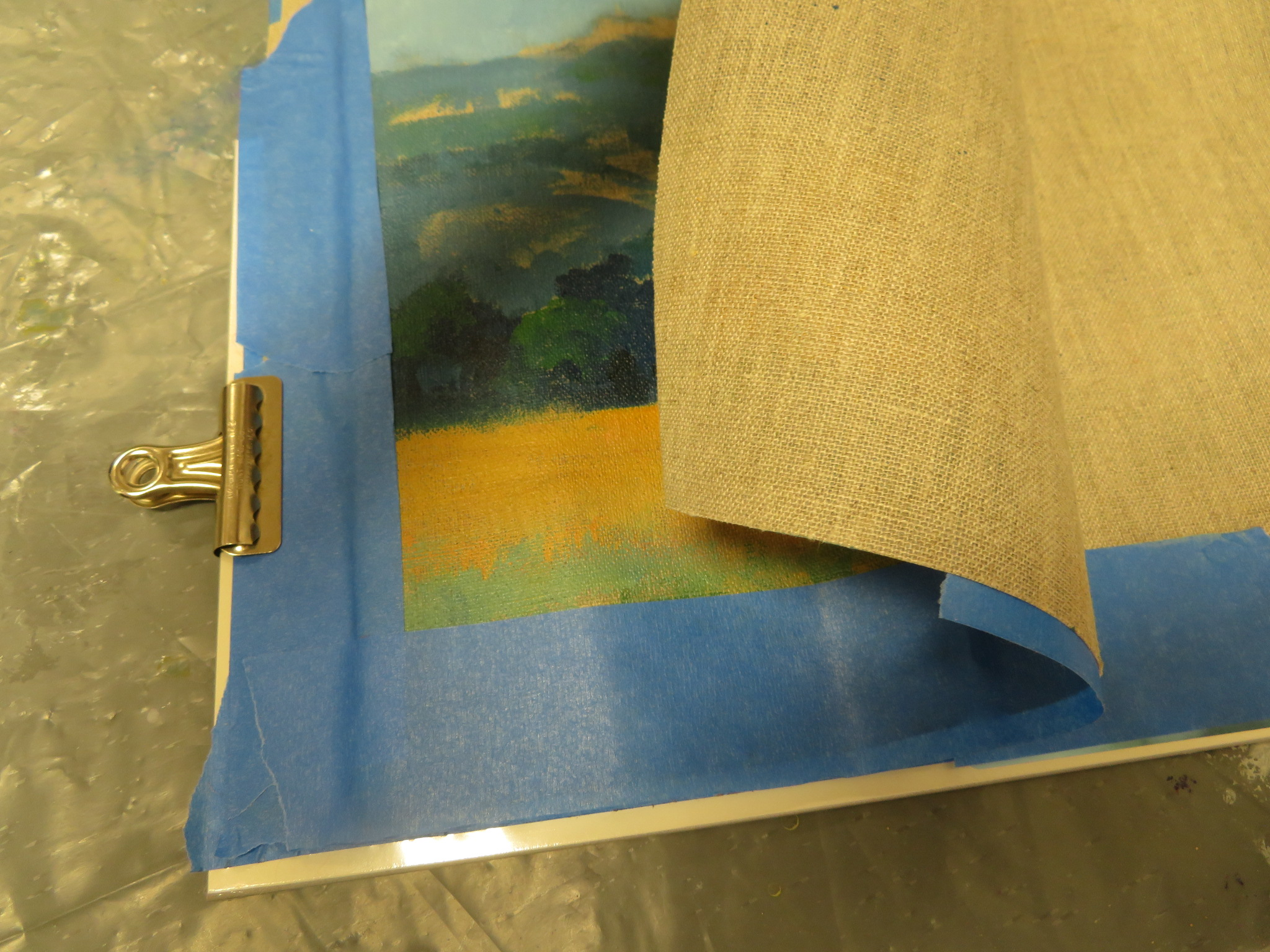 Image 10.  Tape blank canvases on top of each other. After painting, peel the top layer off.