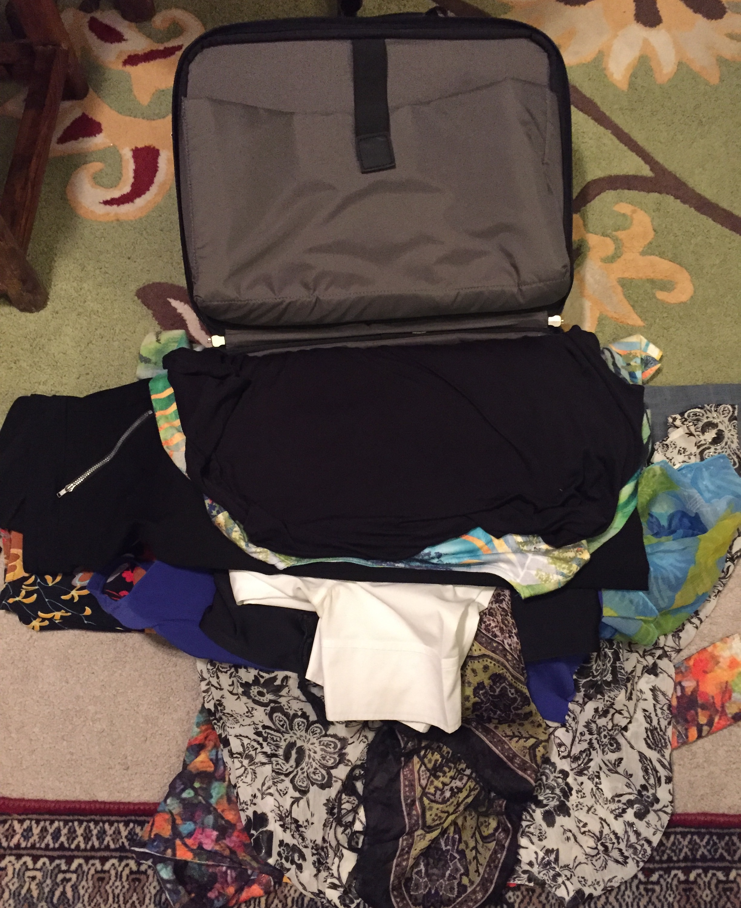Image 1.  In a carry-on place your clothes flat one on top of each other.