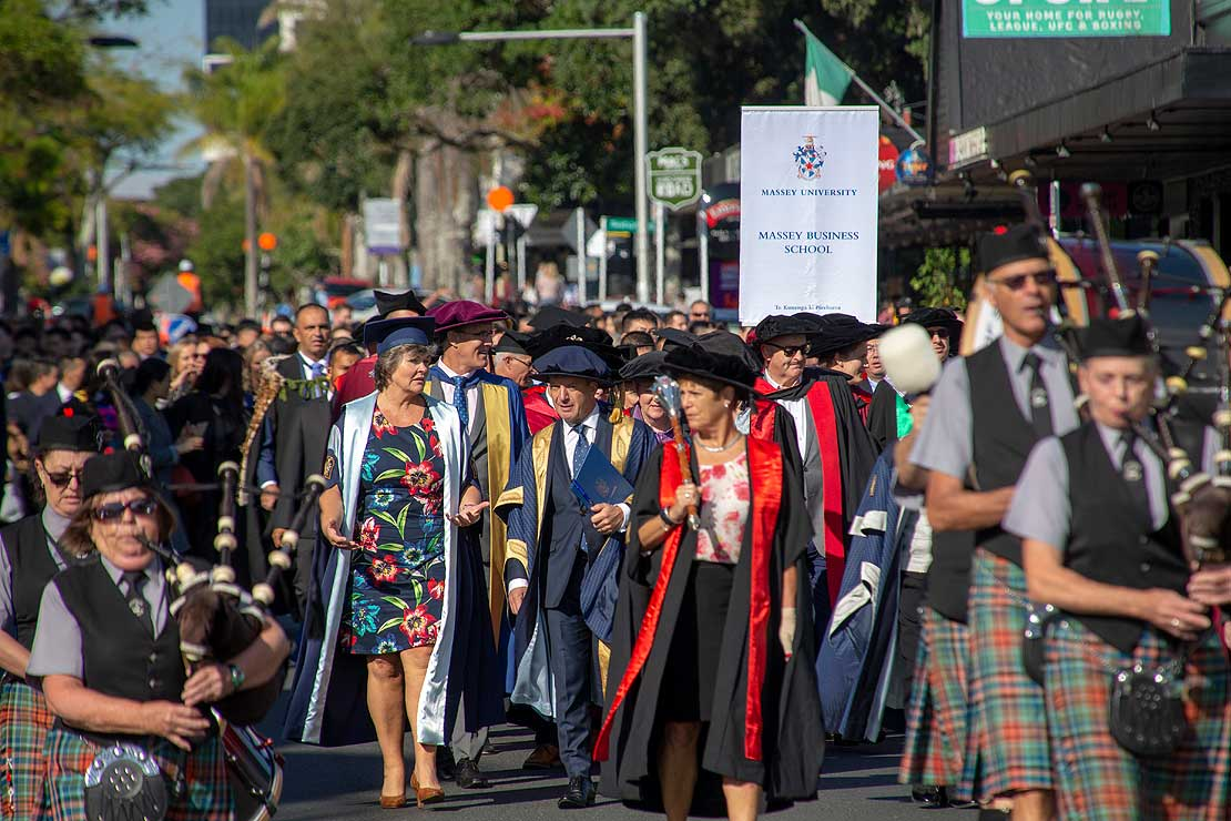 2019 graduands parade down Hurstmere Road to the Bruce Mason Centre in Takapuna