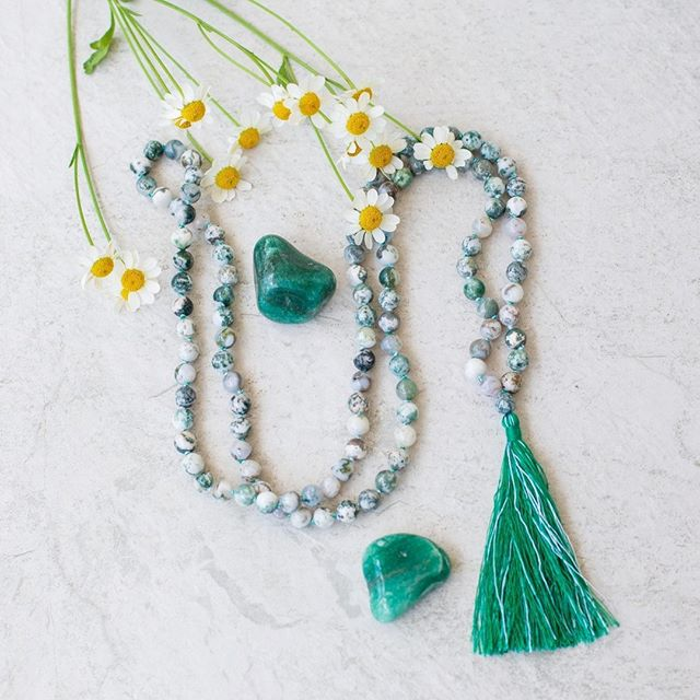 Gemstone spotlight: Tree Agate 🌱 Tree Agate is a stone of inner peace.  It calms nerves and brings our focus to the oneness of us all, dissolving egoism and arrogance.  Tree Agate is a highly supportive stone that boosts the immune system and regulates the balance of water in the body.  Tree Agate helps to clear energy blockages in the Nadis (energy channels) to allow for a greater flow of this energy throughout the body.  In general, Agates carry a quiet energy that works on the subtle bodies, and are great for achieving stability and balance in many aspects of one's life.  Agates tend to work behind the scenes on the cause, instead of the symptom, of an issue.  Agate is believed to improve mental functions and can help where issues of clarity and stability are concerned.  Agate is also helpful in overcoming negative emotions by bringing love into the chakras.  Although they work very slowly and deliberately, this gentle nature of Agate helps them to have a lasting impact 🌱🌱🌱 Should I bring back the FOCUS + GROUNDING Mala? Comment yes if you think so 😊 • • • • • • • • #crystals #healingcrystals #mala #handmade #jewelry #meditation #chakras #selflove #metaphysical #loveandlight #holistichealth #handmadejewelry #crystallove #shopsmall #supportsmallbusiness #buylocal #malaswithamission #malaswithamissiontribe #malabeads #108beads #healingjewelry #healingstones #ethicalshopping #sustainablebrand #consciousconsumer #purchasewithpurpose #crystalmagic #japamala #japameditation #yogajewelry