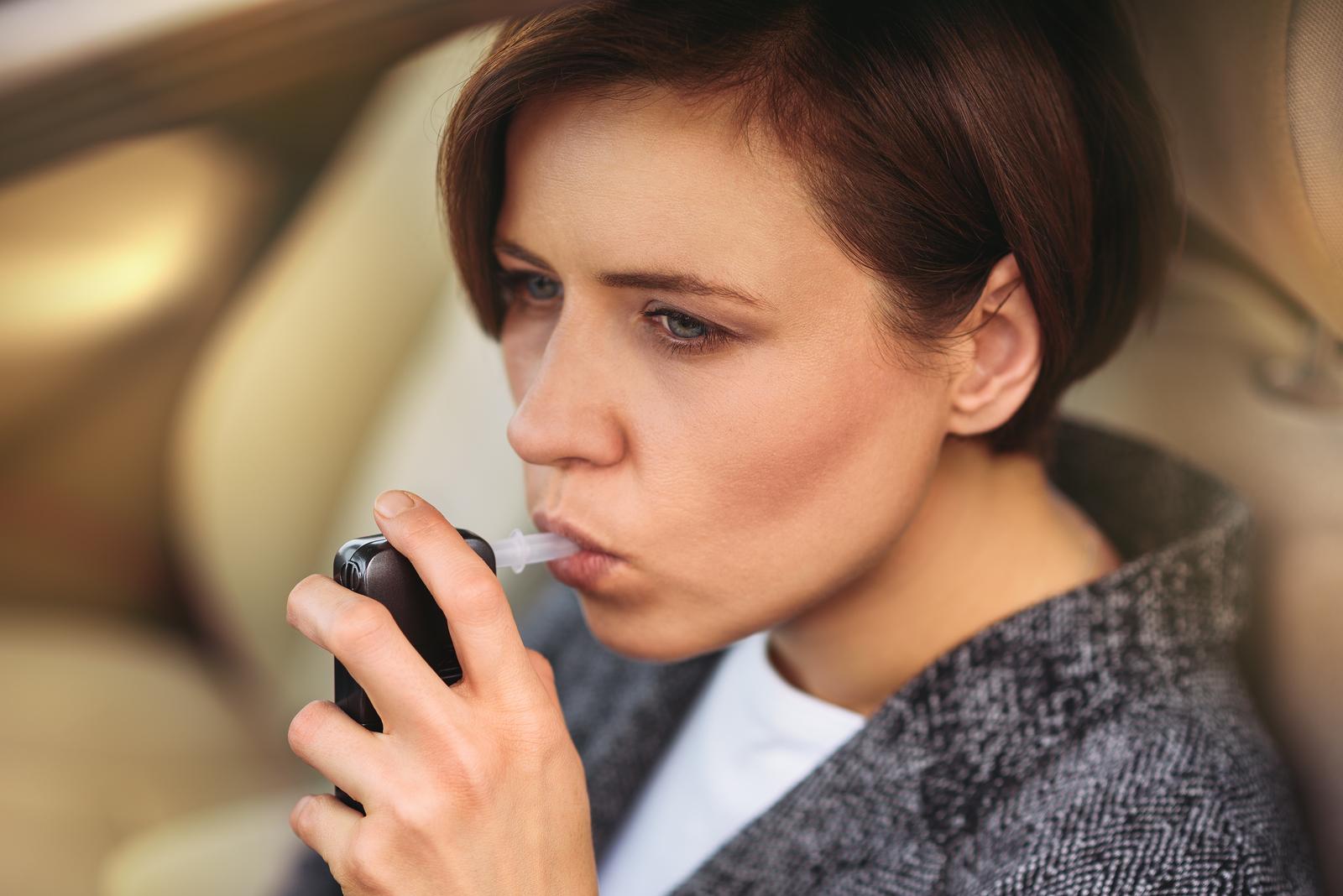 bigstock-Woman-Using-Breath-Alcohol-Ana-262022317.jpg