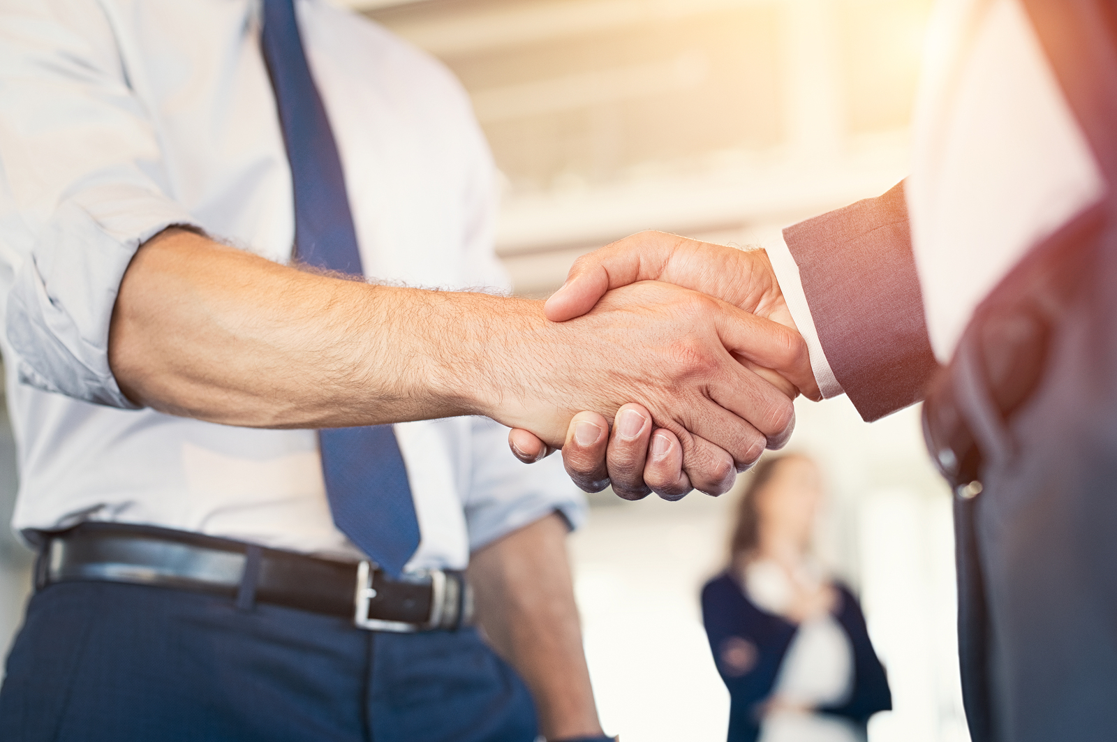 bigstock-Businessmen-shaking-hands-duri-209987992.jpg