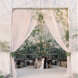 Black Tie Botanical - Elegant, black tie wedding overlooking the ocean with a magical reception in a greenhouse. Photos by Laura Gordonopen gallery