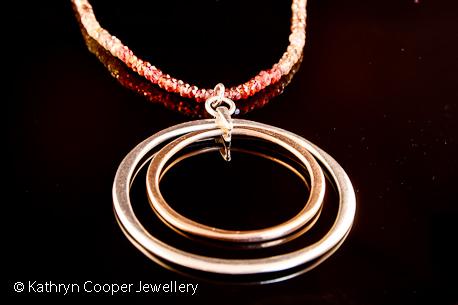 Garnet, sapphire, silver pendant